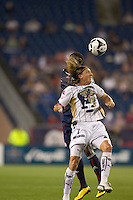 Pumas UNAM midfielder Leandro Augusto (7) and New England Revolution midfielder Joseph Niouky (23) (obscured) battle for head ball. The New England Revolution defeated Pumas UNAM in SuperLiga group play, 1-0, at Gillette Stadium on July 14, 2010.
