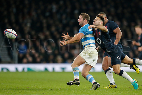 26.11.2016. Twickenham, London, England. Autumn International Rugby. England versus Argentina. Santiago Cordero of Argentina is tackled by Danny Care of England.   Final score: England 27-14 Argentina.