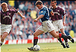 Ally McCoist slots away goal no 4 as Stevie Frail and Gary Mackay look on