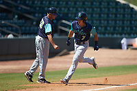Jodd Carter (7) of the Lynchburg Hillcats bumps fists with third base coach Jim Pankovits (20) as he rounds third base after hitting a home run against the Winston-Salem Rayados at BB&T Ballpark on June 23, 2019 in Winston-Salem, North Carolina. The Hillcats defeated the Rayados 12-9 in 11 innings. (Brian Westerholt/Four Seam Images)