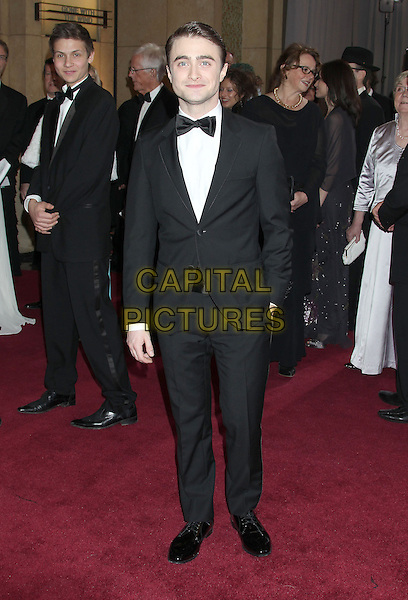 Daniel Radcliffe.85th Annual Academy Awards held at the Dolby Theatre at Hollywood & Highland Center, Hollywood, California, USA..February 24th, 2013.oscars full length hand in pocket black white tuxedo bow tie .CAP/ADM/RE.©Russ Elliot/AdMedia/Capital Pictures.