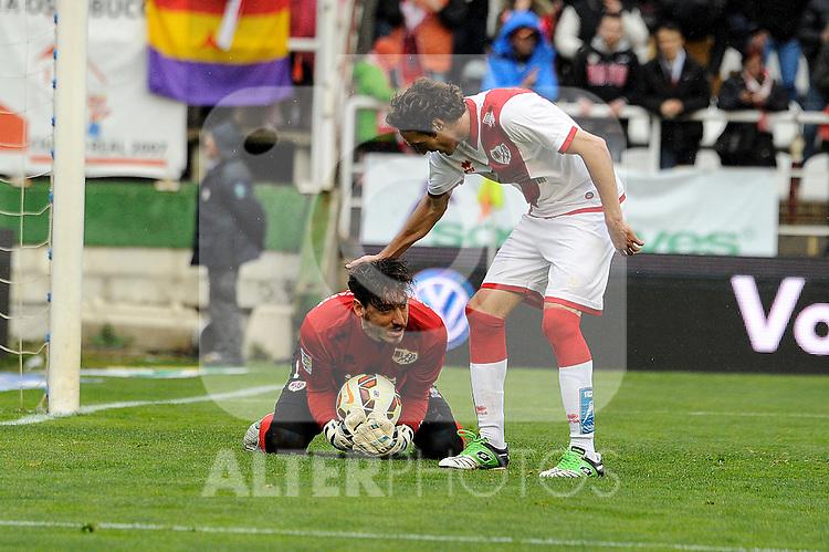 Rayo Vallecano´s goalkeeper Cristian Dario Alvarez and Jose Raul Baena during 2014-15 La Liga match between Rayo Vallecano and Malaga CF at Rayo Vallecano stadium in Madrid, Spain. March 21, 2015. (ALTERPHOTOS/Luis Fernandez)