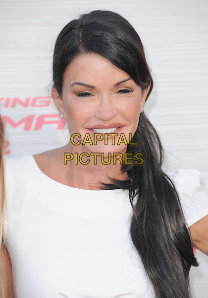 Janice Dickinson.'The Amazing Spider-Man' Premiere held at Regency Village Theater in Westwood, California, USA. .June 28th, 2012.headshot portrait white smiling .CAP/RKE/DVS.©DVS/RockinExposures/Capital Pictures.