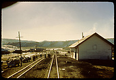 Lumberton? Station, 2 tracks, highway across tracks.<br /> D&amp;RGW  Lumberton, NM