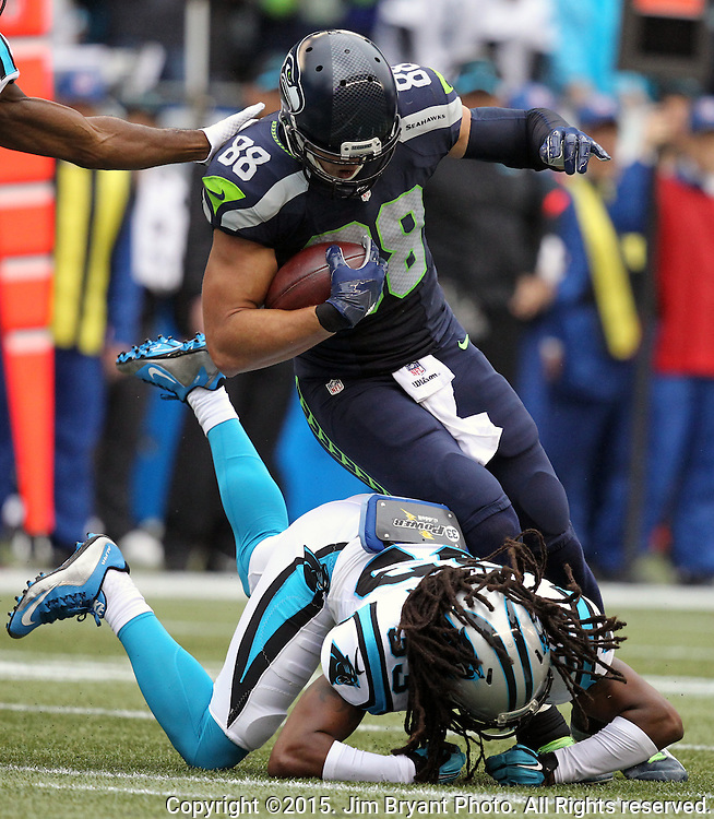 Seattle Seahawks  tight end Jimmy Graham (88) looks for room to run after catch a pass from Russell Wilson against Carolina Panthers  safety Tie Boston (33) at CenturyLink Field in Seattle on October 18, 2015. The Panthers came from behind with 32 seconds remaining in the 4th Quarter to beat the Seahawks 27-23.  ©2015 Jim Bryant Photography. All Rights Reserved.