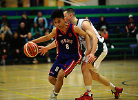 Action from the 2017 AA Boys' Secondary Schools Basketball Premiership National Championship match between Westlake Boys' High School (white and green) and Hastings Boys' High School (navy and red) at the B&M Centre in Palmerston North, New Zealand on Tuesday, 3 October 2017. Photo: Dave Lintott / lintottphoto.co.nz