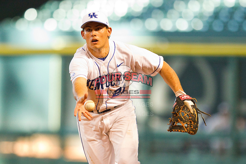 Luke Maile #21 of the Kentucky Wildcats flips the ball towards first base against the Houston Cougars at Minute Maid Park on March 5, 2011 in Houston, Texas.  Photo by Brian Westerholt / Four Seam Images