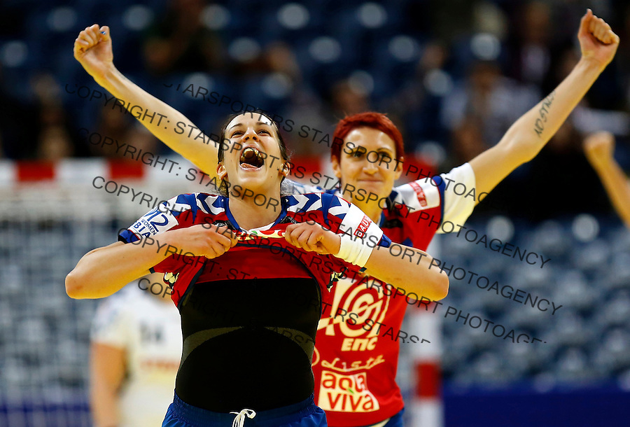 BELGRADE, SERBIA - DECEMBER 08: Andrea Lekic (L) of Serbia celebrates the score during the Women's European Handball Championship 2012 Group A match between Serbia and Czech Republic at Arena Hall on December 08, 2012 in Belgrade, Serbia. (Photo by Srdjan Stevanovic/Getty Images)