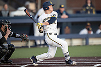Michigan Wolverines third baseman Riley Bertram (12) follows through on his swing against the Western Michigan Broncos on March 18, 2019 in the NCAA baseball game at Ray Fisher Stadium in Ann Arbor, Michigan. Michigan defeated Western Michigan 12-5. (Andrew Woolley/Four Seam Images)