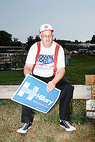 David Cloutier, of Milford, a supporter of Democratic presidential candidate Hillary Clinton, sits down before marching in the Labor Day parade in Milford, New Hampshire. Though Clinton did not march in the parade, Republican candidates John Kasich, Carly Fiorina, and Lindsey Graham, and Democratic candidate Bernie Sanders did march in the parade.