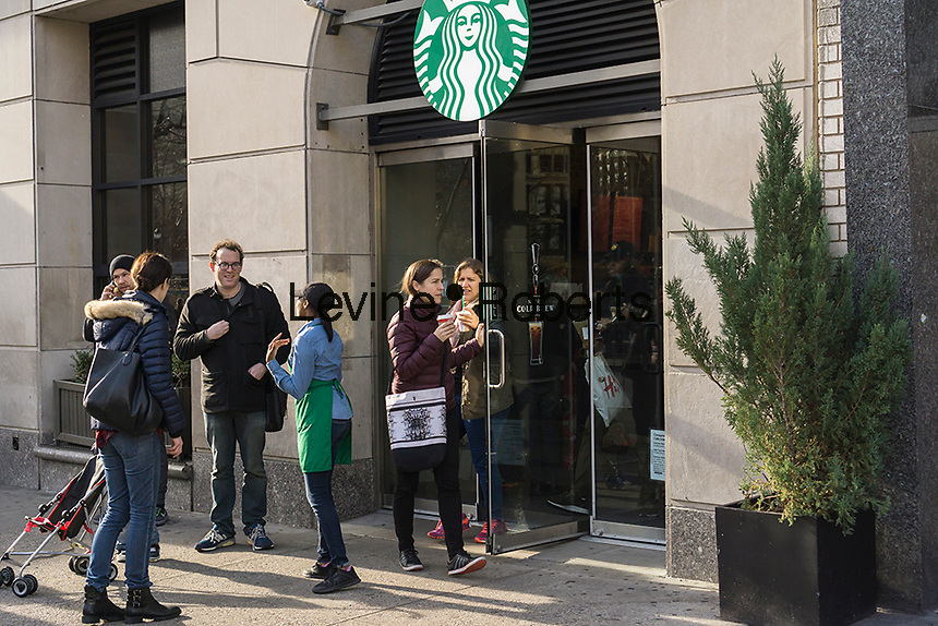 Exterior of a Starbucks during their Starbucks Cheer promotional event in New York on Tuesday, December 27, 2016. For 10 days, excluding Christmas, Starbucks is giving away a tall espresso drink of your choice between the hours 1 and 2PM at a rotating choice of 100 stores around the country. (© Richard B. Levine)