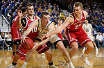 BROOKINGS, SD - FEBRUARY 23: Noah Freidel #11 of the South Dakota State Jackrabbits looks for help while controlling the ball in a double team by Cody Kelley #10 and Tyler Hagedorn #25 of the South Dakota Coyotes Sunday at Frost Arena in Brookings, SD. (Photo by Dave Eggen/Inertia)
