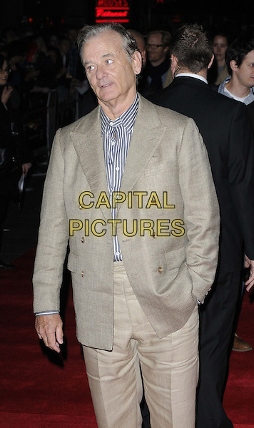 Bill Murray.The 'Hyde Park On Hudson' Centrepiece gala screening, the 56th BFI London Film Festival day 7, Empire cinema, Leicester Square, London, England..October 16th, 2012.half length blue stripe shirt white beige suit hand in pocket arm mouth open   .CAP/CAN.©Can Nguyen/Capital Pictures.