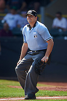 Umpire Matt Snodgrass watches a fly ball during a game between the Great Lakes Loons and Clinton LumberKings on August 16, 2015 at Ashford University Field in Clinton, Iowa.  Great Lakes defeated Clinton 3-2 in ten innings.  (Mike Janes/Four Seam Images)