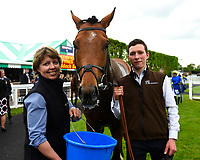 Scorching ridden by Joshua Bryan and trained by Andrew Balding  is seen to by stable staff in the winners enclosure during Afternoon Racing at Salisbury Racecourse on 18th May 2017