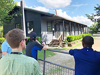NWA Democrat-Gazette/STACY RYBURN<br /> Jonathan Curth (left), Fayetteville planner, and Matt Hoffman (center) and Quintin Canada (right), Fayetteville planning commissioners, view the site of the planned Prairie Street Live venue at 509 W. Prairie St. in Fayetteville on Wednesday, July 3, 2019. The venue's owners will ask the commission Monday for a permit that would allow the business to have live music.