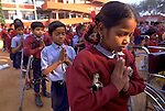 Children line up and pray in the schoolyard before starting class at the Amar Jyoti Rehabilitation Center in Dehli, India. The Amar Jyoti Center is a charitable trust promoting integration for the orthopedically disabled by education, rehabilitation and job opportunities. The school is integrated, mixing physically handicaped children with healthy ones, so they learn to live together.(photo by Jean-Marc Giboux)