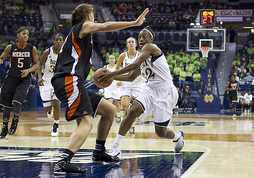 November 20, 2012:  Notre Dame guard Jewell Loyd (32) drives to the basket as Mercer forward Kate Alemann (31) defends during NCAA Women's Basketball game action between the Notre Dame Fighting Irish and the Mercer Bears at Purcell Pavilion at the Joyce Center in South Bend, Indiana.  Notre Dame defeated Mercer 93-36.