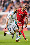 Karim Benzema of Real Madrid (L) in action against Guido Pizarro of Sevilla FC (R) during the La Liga 2017-18 match between Real Madrid and Sevilla FC at Santiago Bernabeu Stadium on 09 December 2017 in Madrid, Spain. Photo by Diego Souto / Power Sport Images