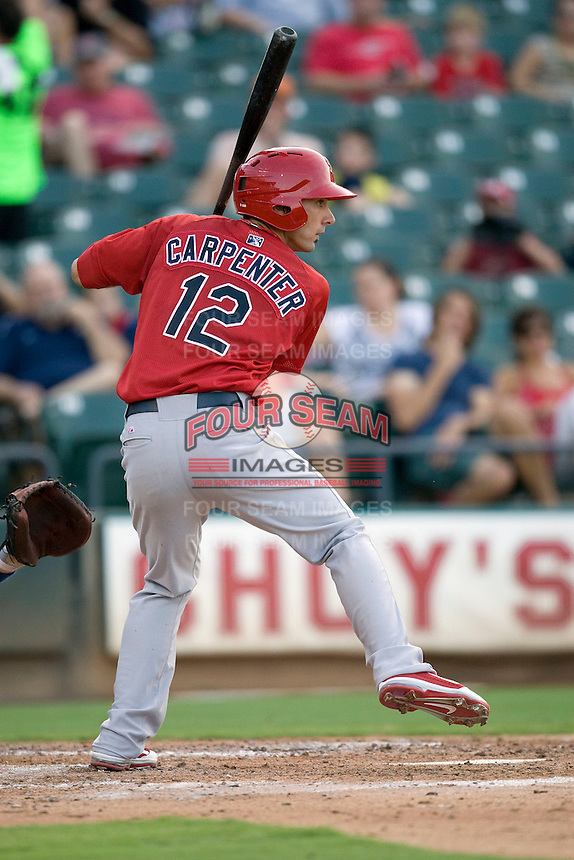Memphis Redbirds third baseman Matt Carpenter #12 at bat against the Round Rock Express at the Dell Diamond on July 10, 2011 in Round Rock, Texas.  Memphis defeated Round Rock 10-9.  (Andrew Woolley / Four Seam Images)