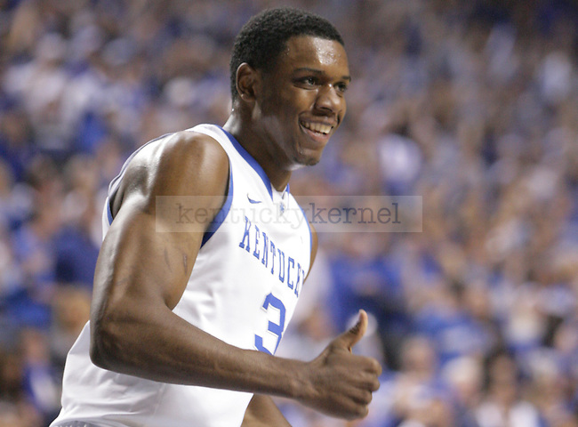 UK forward Terrence Jones gives a thumbs up after a slam dunk during the first half of UK's home game against North Carolina at Rupp Arena in Lexington, Ky., Dec. 1, 2011. Photo by Brandon Goodwin
