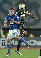BOGOTA - COLOMBIA -31 -03-2016: Michael Rangel (Izq) jugador de Millonarios disputa el balón con Alexis Henriquez (Der.) jugador de Nacional, durante partido aplazado de la fecha 9 entre Millonarios Atletico Nacional, de la Liga Aguila I-2016, jugado en el estadio Nemesio Camacho El Campin de la ciudad de Bogota.  / Michael Rangel (L) jugador of Millonarios vies for the ball with Alexis Henriquez (R) player of Nacional, during a postponed match between Millonarios and Atletico Nacional,  for the date 9 of the Liga Aguila I-2016 at the Nemesio Camacho El Campin Stadium in Bogota city. Photo: VizzorImage / Gabriel Aponte / Staff.