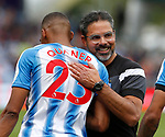 David Wagner manager of Huddersfield Town hugs Collin Quaner of Huddersfield Town  during the premier league match at the John Smith's Stadium, Huddersfield. Picture date 20th August 2017. Picture credit should read: Simon Bellis/Sportimage