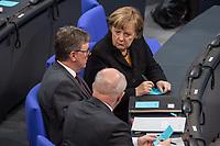 7. Sitzung des Deutschen Bundestag am Donnerstag den 18. Januar 2018.<br /> Im Bild: Bundeskanzlerin Angela Merkel im Gespraech mit Michael Grosse-Broemer, CDU, Erster Parlamentarischer Geschaeftsfuehrer der CDU/CSU-Fraktion (links) und Volker Kauder, CDU, Vorsitzender der CDU/CSU-Bundestagsfraktion (Ruecken).<br /> 18.1.2018, Berlin<br /> Copyright: Christian-Ditsch.de<br /> [Inhaltsveraendernde Manipulation des Fotos nur nach ausdruecklicher Genehmigung des Fotografen. Vereinbarungen ueber Abtretung von Persoenlichkeitsrechten/Model Release der abgebildeten Person/Personen liegen nicht vor. NO MODEL RELEASE! Nur fuer Redaktionelle Zwecke. Don't publish without copyright Christian-Ditsch.de, Veroeffentlichung nur mit Fotografennennung, sowie gegen Honorar, MwSt. und Beleg. Konto: I N G - D i B a, IBAN DE58500105175400192269, BIC INGDDEFFXXX, Kontakt: post@christian-ditsch.de<br /> Bei der Bearbeitung der Dateiinformationen darf die Urheberkennzeichnung in den EXIF- und  IPTC-Daten nicht entfernt werden, diese sind in digitalen Medien nach &sect;95c UrhG rechtlich geschuetzt. Der Urhebervermerk wird gemaess &sect;13 UrhG verlangt.]