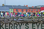 Spectators gather on the shore at Portmagee to watch the 'Duck Race'
