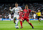 Gareth Bale (L) of Real Madrid is tackled by Joshua Kimmich of FC Bayern Munich during the UEFA Champions League Semi-final 2nd leg match between Real Madrid and Bayern Munich at the Estadio Santiago Bernabeu on May 01 2018 in Madrid, Spain. Photo by Diego Souto / Power Sport Images