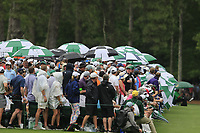 Umbrellas up for a small shower during the final round at the The Masters , Augusta National, Augusta, Georgia, USA. 14/04/2019.<br /> Picture Fran Caffrey / Golffile.ie<br /> <br /> All photo usage must carry mandatory copyright credit (© Golffile | Fran Caffrey)