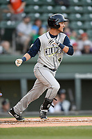 Third baseman Rigoberto Terrazas (9) of the Columbia Fireflies bats in a game against the Greenville Drive on Wednesday, April 18, 2018, at Fluor Field at the West End in Greenville, South Carolina. Columbia won 8-4. (Tom Priddy/Four Seam Images)
