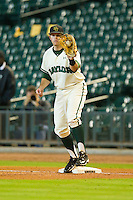 First baseman Max Muncy #9 of the Baylor Bears fields a throw against the Utah Utes at Minute Maid Park on March 5, 2011 in Houston, Texas.  Photo by Brian Westerholt / Four Seam Images