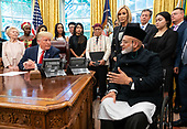 United States President Donald J. Trump talks to Farid Ahmed, a survivor of the Mosque shooting in Christchurch New Zealand, as he meets with survivors of religious perception in the Oval Office at the White House in Washington, D.C. on Wednesday, July 17, 2019. <br /> Credit: Kevin Dietsch / Pool via CNP