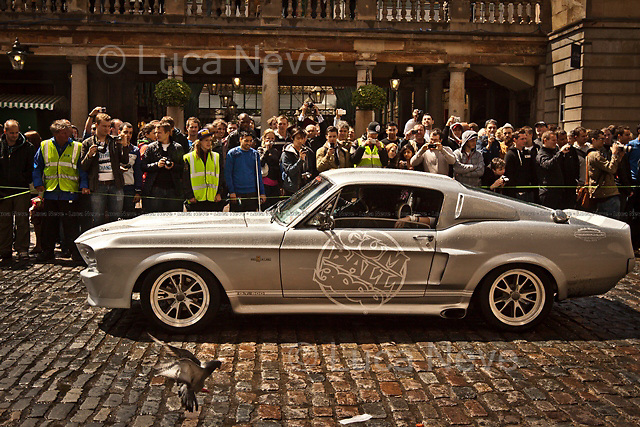 """London, 26/05/2011. Over one hundred expensive """"bolides"""" gathered in Covent Garden to attend the start of the rally that, on a 3000 miles journey, will cross 10 different countries to end in Istanbul. Among the participants and some celebrities present is David Hasselhoff, who famously played Michael Knight in the 1980's TV series Knight Rider."""
