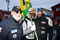 The first ever Jamaican Iditarod musher, Newton Marshall, poses with the founder of the Jamaican dog sled team, Danny Melville (L) and Iditarod champion Lance Mackey whos dogs Newton used at the Nome finish line during the 2010 Iditarod