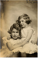 BNPS.co.uk (01202 558833)<br /> Pic: MarcusAdams/ChiswickAuctions/BNPS<br /> <br /> 1934 - Princess Elizabeth (8) and Princess Margaret (4)<br /> <br /> Charming childhood photos of Princess Elizabeth and Princess Margaret have come to light, including a previously unseen image of the future Queen in a kilt.<br /> <br /> The portraits, taken by acclaimed British society photographer Marcus Adams, capture the future Queen from being a baby to her adolescence.<br /> <br /> The Queen Mother would often take her daughters to his central London studio where he would set up toys and props to keep them entertained