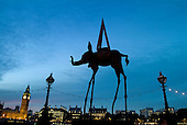A sculpture of an elephant by Salvador Dali outside a gallery on the South Bank of the River Thames, with Big Ben in the background