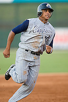 Karexon Sanchez (10) of the Lake County Captains hustles into third base at Fieldcrest Cannon Stadium in Kannapolis, NC, Wednesday July 2, 2008. (Photo by Brian Westerholt / Four Seam Images)
