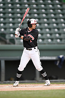 Third baseman Jared Williams (1) of the North Greenville Crusaders bats in a game against the Queens University Royals on Tuesday, March 12, 2019, at Fluor Field at the West End in Greenville, South Carolina. North Greenville won, 14-3. (Tom Priddy/Four Seam Images)