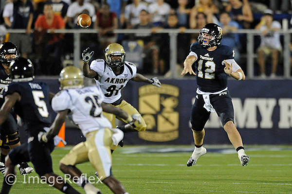 8 September 2012:  FIU quarterback Jake Medlock (12) passes in the third quarter as the FIU Golden Panthers defeated the Akron Zips, 41-38 (overtime), at FIU Stadium in Miami, Florida.