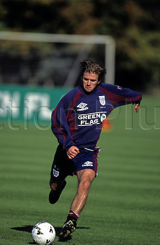 4 October 1996: England midfielder David Beckham kicking the ball during England training at Bisham Abbey, Buckinghamshire.  Photo: Glyn Kirk/Actionplus..961004 man men player football practice practicing kick