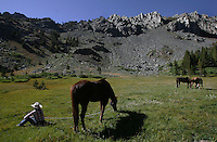 Backcountry guide Mindy Foley grazes her horse in a pasture near Purple lake last season, August 2006.  Mammoth Lakes Pack Outfit provides access to remote parts of the Eastern Sierras, without hauling all the gear, or walking for that matter.