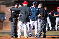 Shippensburg Raiders head coach Matt Jones listens as Belmont Abbey Crusaders head coach Chris Anderson goes over the grounds rules at Abbey Yard on February 8, 2015 in Belmont, North Carolina.  The Raiders defeated the Crusaders 14-0.  (Brian Westerholt/Four Seam Images)