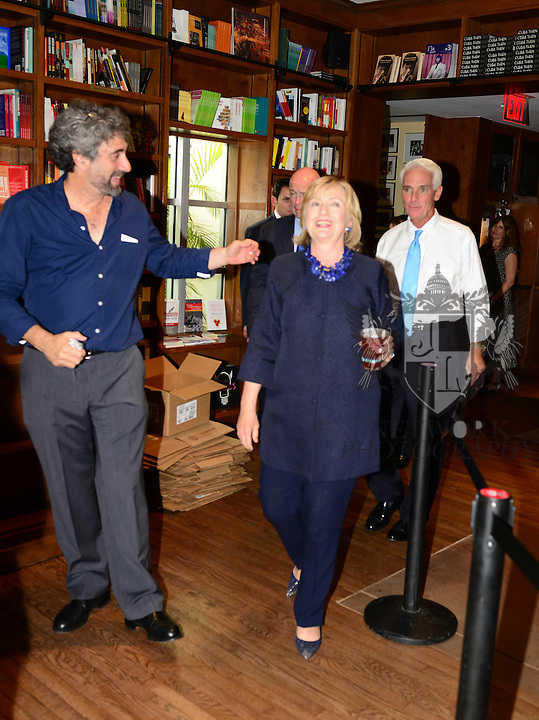 CORAL GABLES, FL - OCTOBER 02: Mitchell Kaplan,Hillary Rodham Clinton and Charlie Crist walking at the Books and Books cafe thinking the staff after greeting fans and signs copies of her book 'Hard Choices' at Books and Books on Thursday October 2, 2014 in Coral Gables, Florida. (Photo by Johnny Louis/jlnphotography.com)