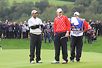 2010 Ryder Cup at the Celtic Manor twenty ten course, Newport Wales, 1/10/2010 on day one of play After play restarted at 5 pm..Tiger Woods and Ian Poulter watch as Steve Stricker drops his ball on the 4th..Picture Fran Caffrey/www.golffile.ie.