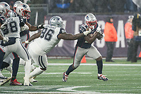 FOXBOROUGH, MA - NOVEMBER 24: Dallas Cowboys Defensive tackle Maliek Collins #96 reaches for New England Patriots Runningback Sony Michel #26 as he passes on the run during a game between Dallas Cowboys and New England Patriots at Gillettes on November 24, 2019 in Foxborough, Massachusetts.