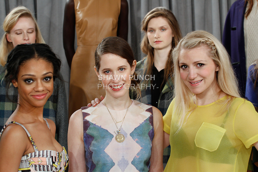 Actress Tiffany Boone (left) fashion designer Jordana Warmflash (Center), and actress Annaleigh Ashford, pose together at the Novis Autumn Winter 2014 collection fashion presentation, during New York Fashion Week Fall 2014, on February 7, 2014.