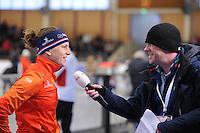 SCHAATSEN: BERLIJN: Sportforum Berlin, 07-12-2014, ISU World Cup, Ireen Wüst (NED), wordt geïnterviewd door Bert Maalderink (NOS televisie), ©foto Martin de Jong