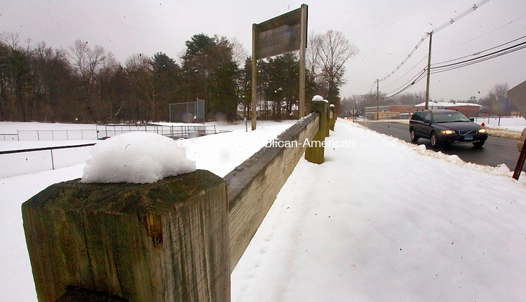 SOUTHBURY, CT. 24 February 2012-022412SV10-Snow tops a fence along George F. Ewald Park in Southbury Friday. An early morning storm dumped from 1-5 inches of snow on the area..Steven Valenti Republican-American